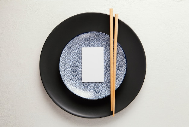 Flat lay arrangement of elegant tableware with smartphone