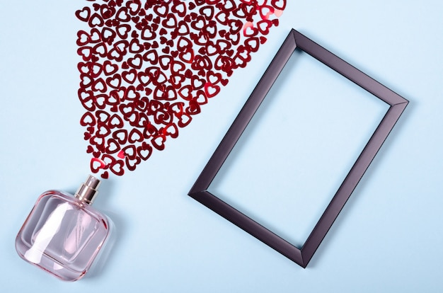 Flat lay arrangement of hearts and perfume bottle for mock up design
