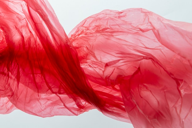 Flat lay arrangement of red plastic bags