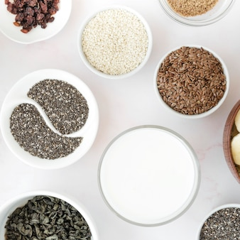 Flat lay arrangement of seeds in bowls