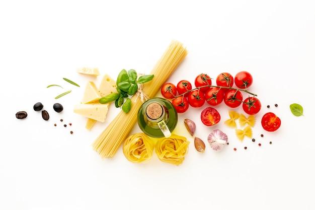 Flat lay arrangement of uncooked pasta and ingredients