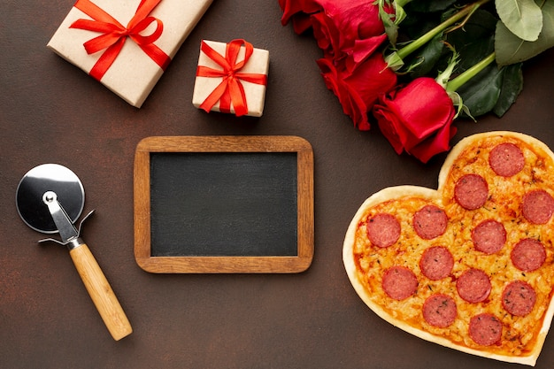 Flat lay arrangement for valentines day with empty blackboard