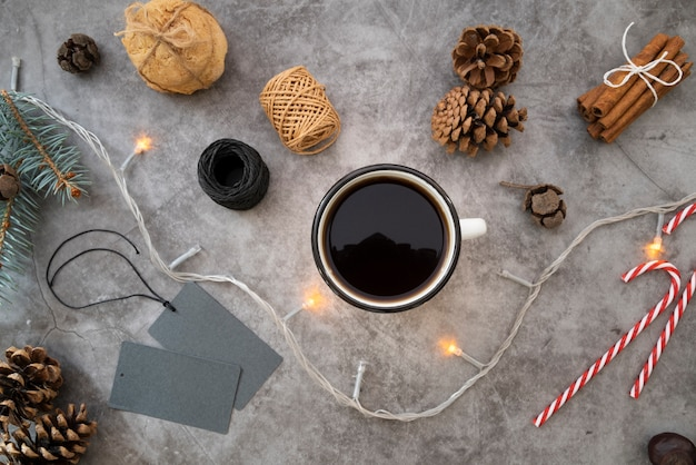 Flat lay arrangement with coffee cup on stucco background