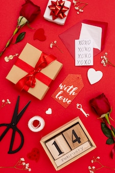 Flat lay arrangement with gifts on red background