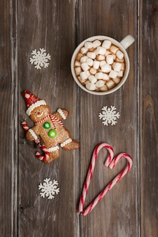 Flat lay arrangement with gingerbread man and drink