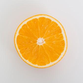 Flat lay arrangement with half orange on white background