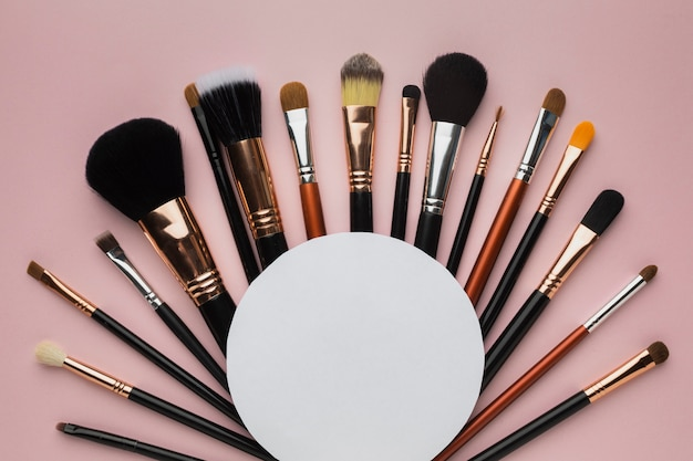 Flat lay arrangement with make-up brushes