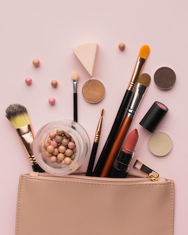 Flat lay arrangement with make-up products with beauty bag