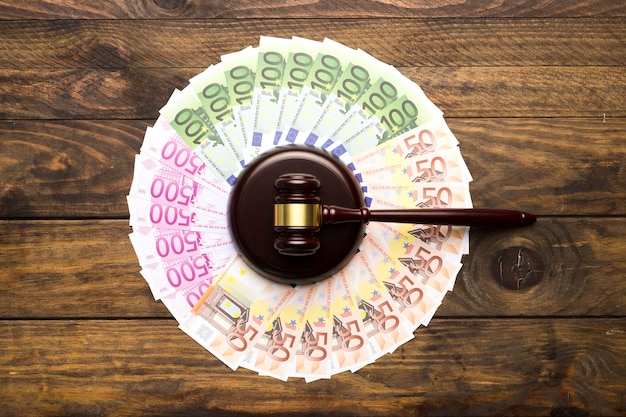 Flat lay arrangement with money and judge gavel