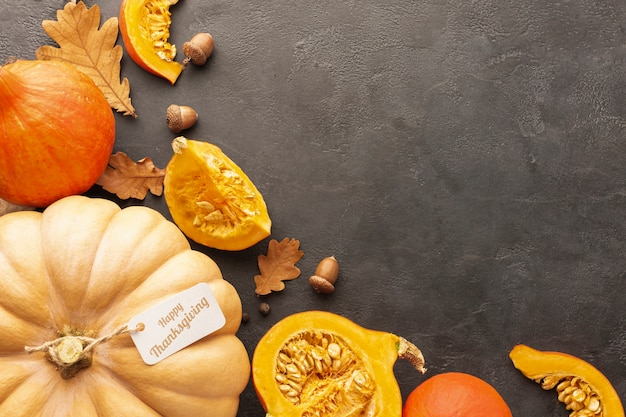 Flat lay arrangement with pumpkins on stucco background