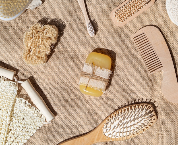 Flat lay arrangement with soap, comb and brushes