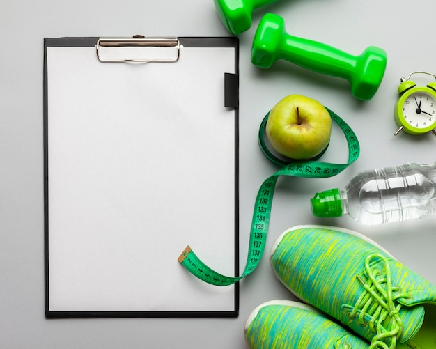 Flat lay arrangement with sports attributes and clipboard