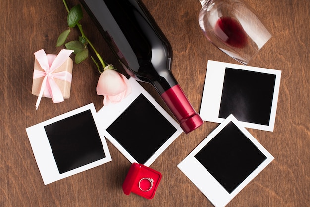 Flat lay arrangement with wine and photos