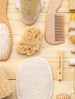 Flat lay arrangement with wooden care products