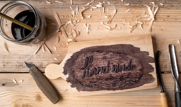 Flat lay artisan jobs equipment and hand made words on wood