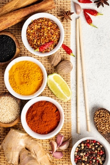 Flat lay asian food spices mix and chopsticks