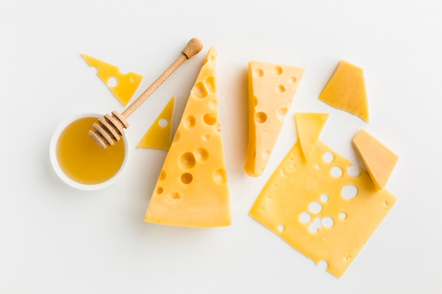 Flat lay assortment of cheese with honey