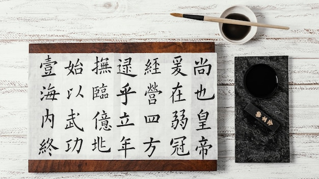 Flat lay assortment of chinese symbols written with ink
