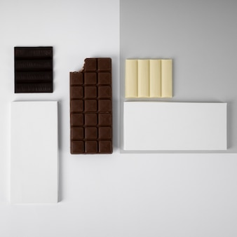 Flat lay of assortment of chocolate bars with packaging