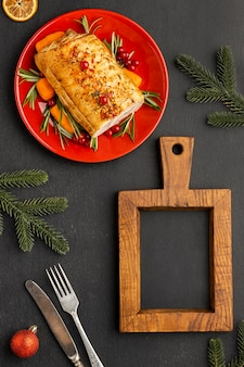 Flat lay assortment of christmas food with empty blackboard