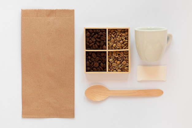 Flat lay assortment of coffee branding elements on white background