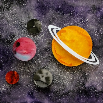 Flat lay assortment of creative paper planets