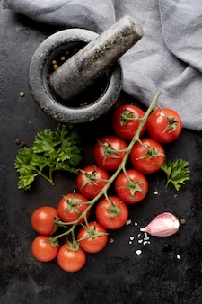 Flat lay assortment of delicious fresh tomatoes