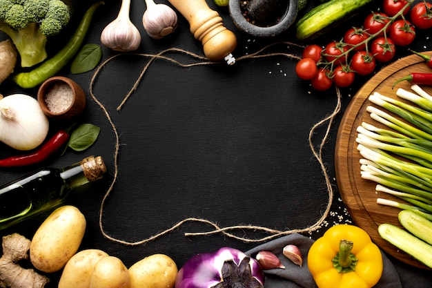 Flat lay assortment of delicious fresh vegetables with copy space