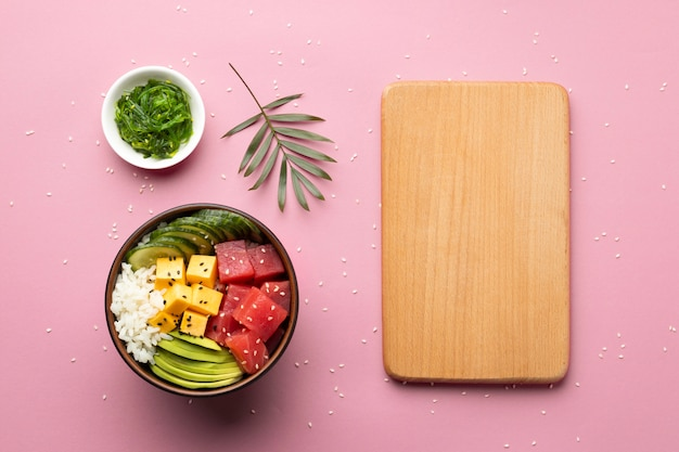 Flat lay assortment of delicious poke bowl