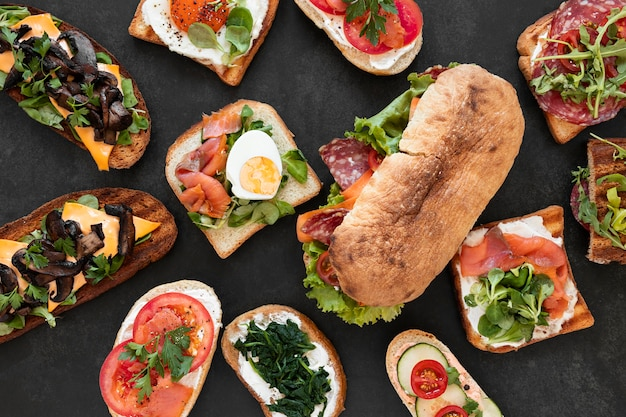Flat lay assortment of delicious sandwiches