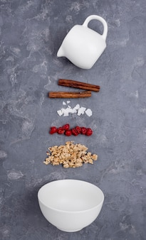 Flat lay assortment of different ingredients on grey background