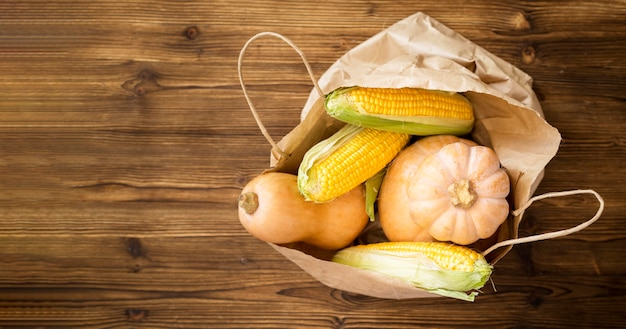 Flat lay assortment of fresh autumnal vegetables with copy space