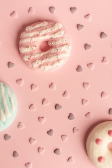 Flat lay of assortment of glazed doughnuts with hearts