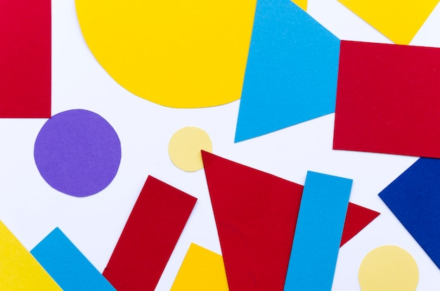 Flat lay of assortment of multicolored paper shapes