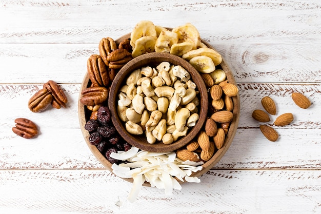 Flat lay of assortment of nuts in bowls
