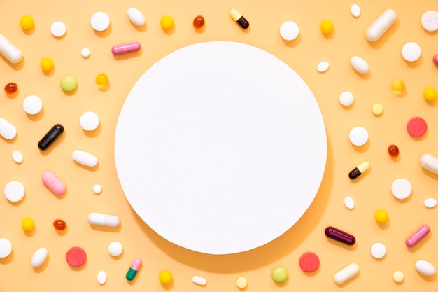 Flat lay of assortment of pills with circle in middle