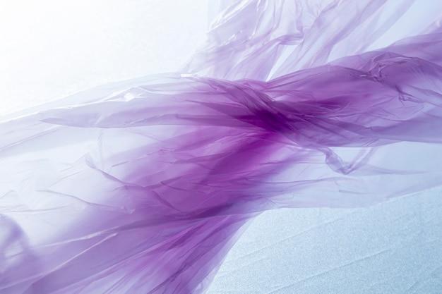 Flat lay assortment of purple plastic bags