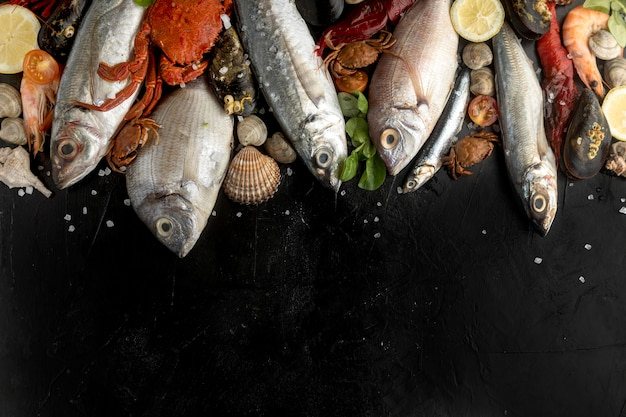 Flat lay of assortment of seafood with copy space