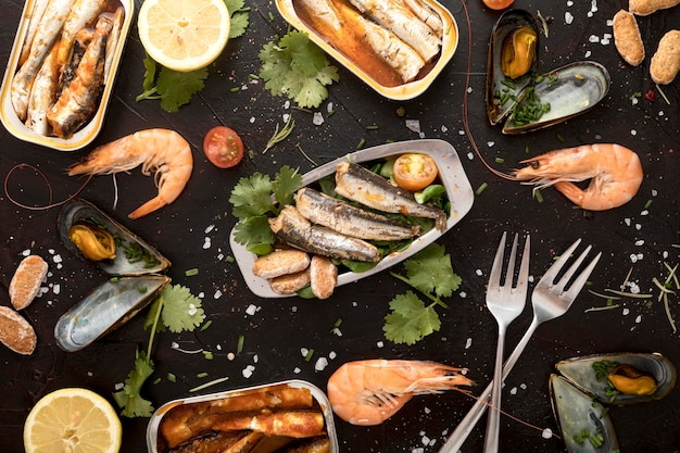 Flat lay of assortment of seafood with cutlery