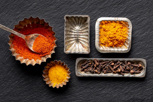 Flat lay of assortment of spices with clove