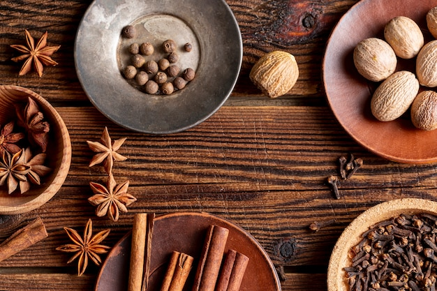 Flat lay of assortment of spices with star anise and cinnamon sticks