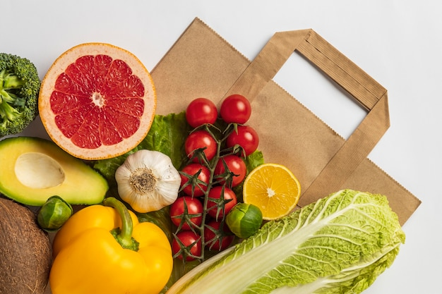 Flat lay of assortment of vegetables with paper bag