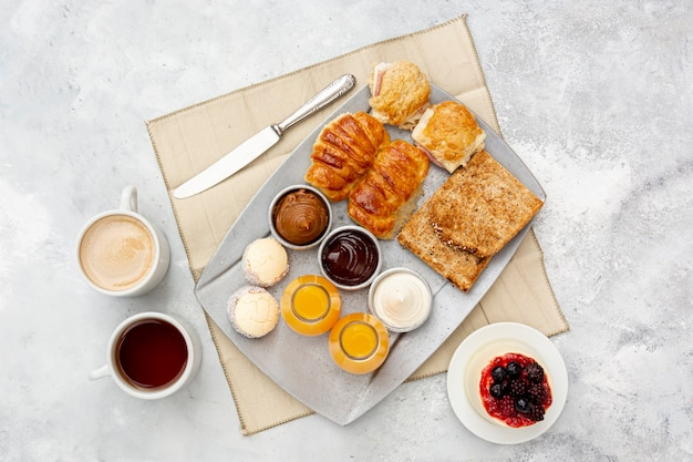 Flat lay assortment with delicious breakfast and cappuccino