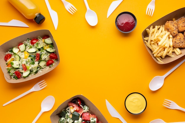 Flat lay assortment with food frame and tableware