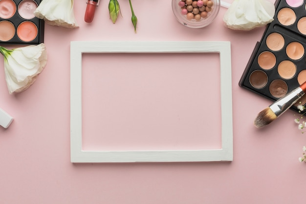 Flat lay assortment with make-up products and frame