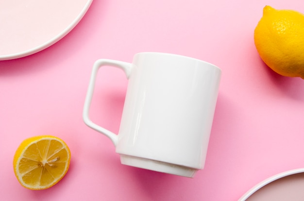 Flat lay assortment with mug and pink background