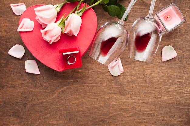Flat lay assortment with pink rose petals