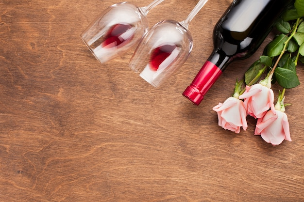 Flat lay assortment with roses and wine
