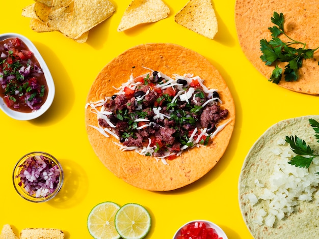 Flat lay assortment with traditional mexican food