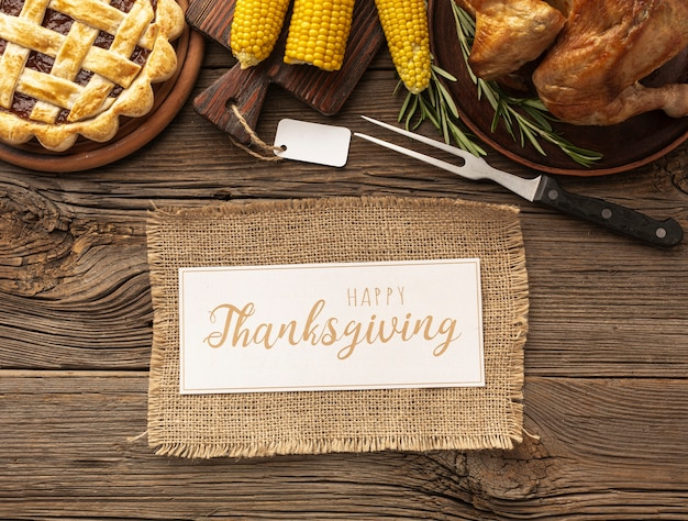 Flat lay assortment with turkey and thanksgiving sign